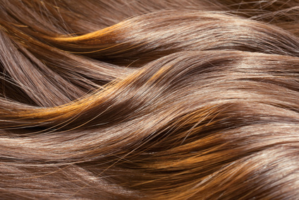 Beautiful healthy shiny hair texture with highlighted golden streaks