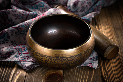 Singing bowl on prayer shawl