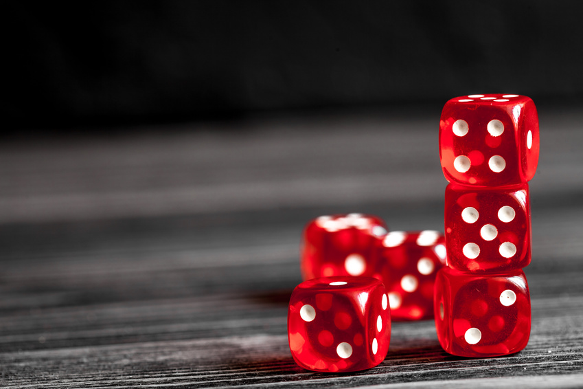 dice gambling on dark wooden background.